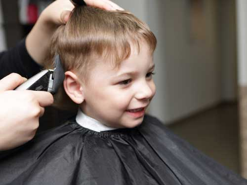 Little boy getting a haircut